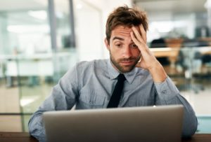 Business man with hand on head frustrated about his backup disaster recovery (BDR) plan