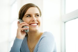 Woman using internet based phone services