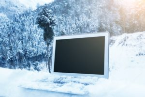 The right backup disaster recovery solution this winter season shown with a laptop in the snow after a blizzard