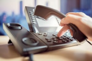 Dialing telephone keypad. VoIP telephony and the benefits