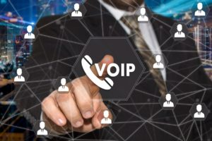The businessman chooses VOIP button on the touch screen with a futuristic background .The concept VOIP
