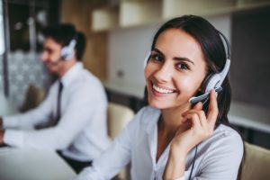 Call center workers using a cloud-based phone system or VoIP Phone System