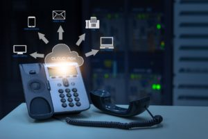 IP Telephony cloud pbx concept, telephone device with illustration icon of voip services