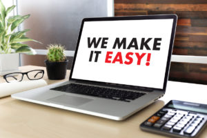 WE MAKE IT EASY! on laptop screen, Managed Service Provider (MSP) concept