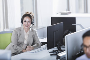 Woman in office cubicle using a Managed Service Provider (MSP) for business protection