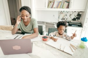 Multitasking mom working from home with the employment perks of offering integrating VOIP phones