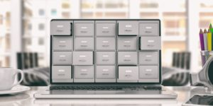 Digitizing your business documents shown with filing cabinet drawers on a computer screen