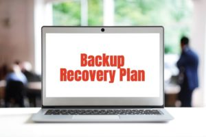 Backup Recovery Plan on a laptop screen in office