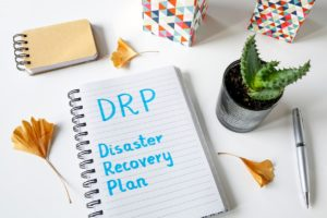 DRP Disaster Recovery Plan written in a notebook