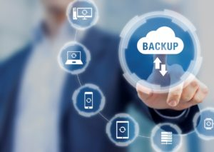 Backup files and data on internet with cloud storage technology that sync all online devices and computers with network connection, protection against loss, business person touch screen icon