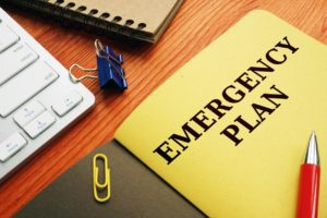 A folder containing emergency/disaster recovery plans